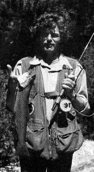 The author with a speckled brownie taken on a cicada pattern from the edge of Lake Wakatipu.