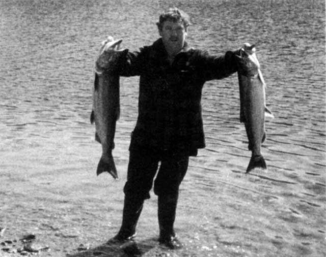 "Graeme ""The Butcher"" Larsen at Lake Paringa. With a one fish limit, the smaller salmon was caught by his brother, West Coast Quinnat Salmon."