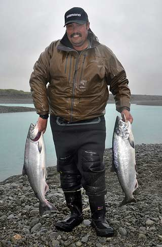 Salmon Fishing. The author with a limit bag from the Rakaia River gut on a wet, windy morning.
