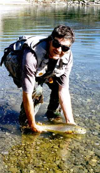 Aaron Horrell prepares to release a Lake Dunstan brown trout. The brownie was ambushed with a snail fly. Photo Dick Marquand.