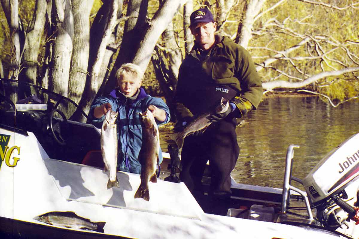 Young Stephen Burgess, and Neville Olson, from the Woolston Club, display their catch.