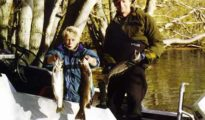 Young Stephen Burgess, and Neville Olson, from the Woolston Club, display their catch. Featured image.