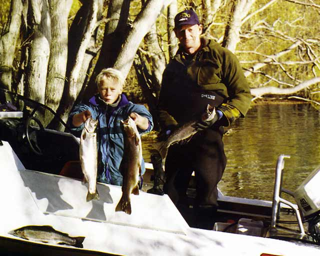 Young Stephen Burgess, and Neville Olson, from the Woolston Club, display their catch. Lake Benmore.