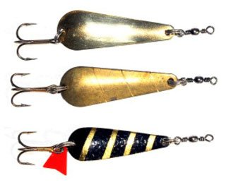 Glimmy spoon lures From top; silvered, gold (plain brass), and black and gold stripe (zebra).