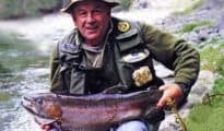 Monty Wright with 12 lb rainbow hen from the Caples River. Photograph John Todd. Featured image.