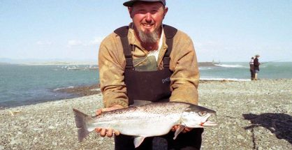 Johnny Richards with a big sea-run brown trout caught at the Rakaia River mouth.