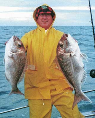 Jim Stenhouse with a pair of big snapper. Deep-Sea Fishing.
