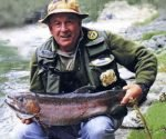 Monty Wright with 12 lb rainbow hen from the Caples River. Photograph John Todd.