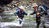 Denis Brundell helping Rod across the Greenstone River. Fishing the Caples River. Featured Image.