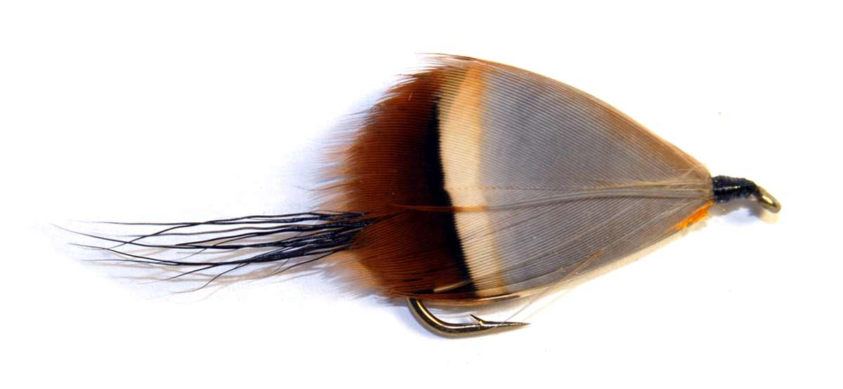 The Orange Witch is a handsome fly or killer style pattern. It uses the flank feathers of the chukor partridge.