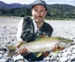 The author with a butter coloured brown trout taken from the lower Wairau River. Tagging. Featured image.