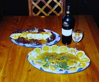 Trout Recipe: Top dish: Almond trout with tangy lemon sauce. Front: Almond Trout with an Orange, Honey and Ginger Sauce.