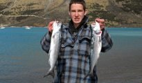 Mark Burgess with a brace of typical salmon from Lake Coleridge. They were taken on spinning gear at the Harper River mouth.