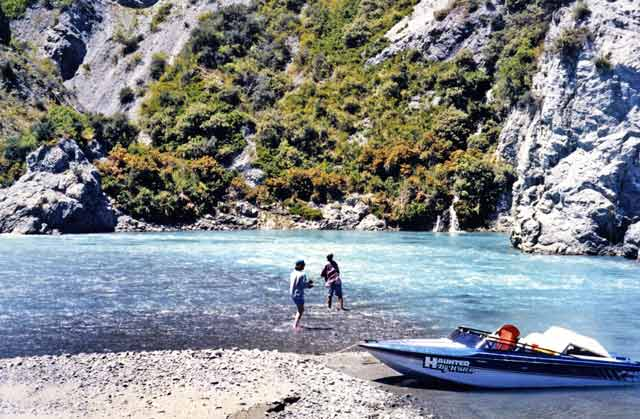A family affair. The author's mother and 13 year old son cast for salmon in the Waimakariri Gorge. Jet boat.
