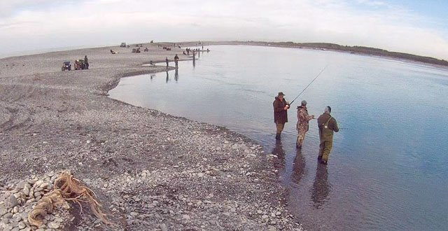 Salmon fishers fishing the main flow in the lower Rakaia River.