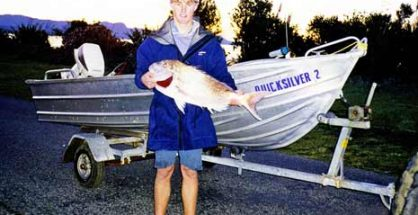 A tinnie is a great asset to have when snapper fishing. Here the author has caught a 17 pound snapper from Quicksilver 2.
