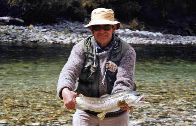 Murray with a beautiful back country brown trout. Fiordland Back Country Trout Fishing by Murray Knowles.