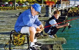 Youngsters learning how to catch fish wharf and jetty fishing is an important part of growing up in New Zealand. This is where most of us start out as anglers like these two boys on a brilliant sunny day at Oamaru.