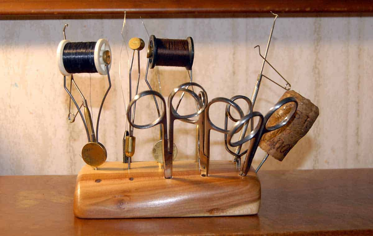 The author's desktop fly tying tool holder makes is much faster to find them when you need them. Made from an off-cut from an old plum tree.