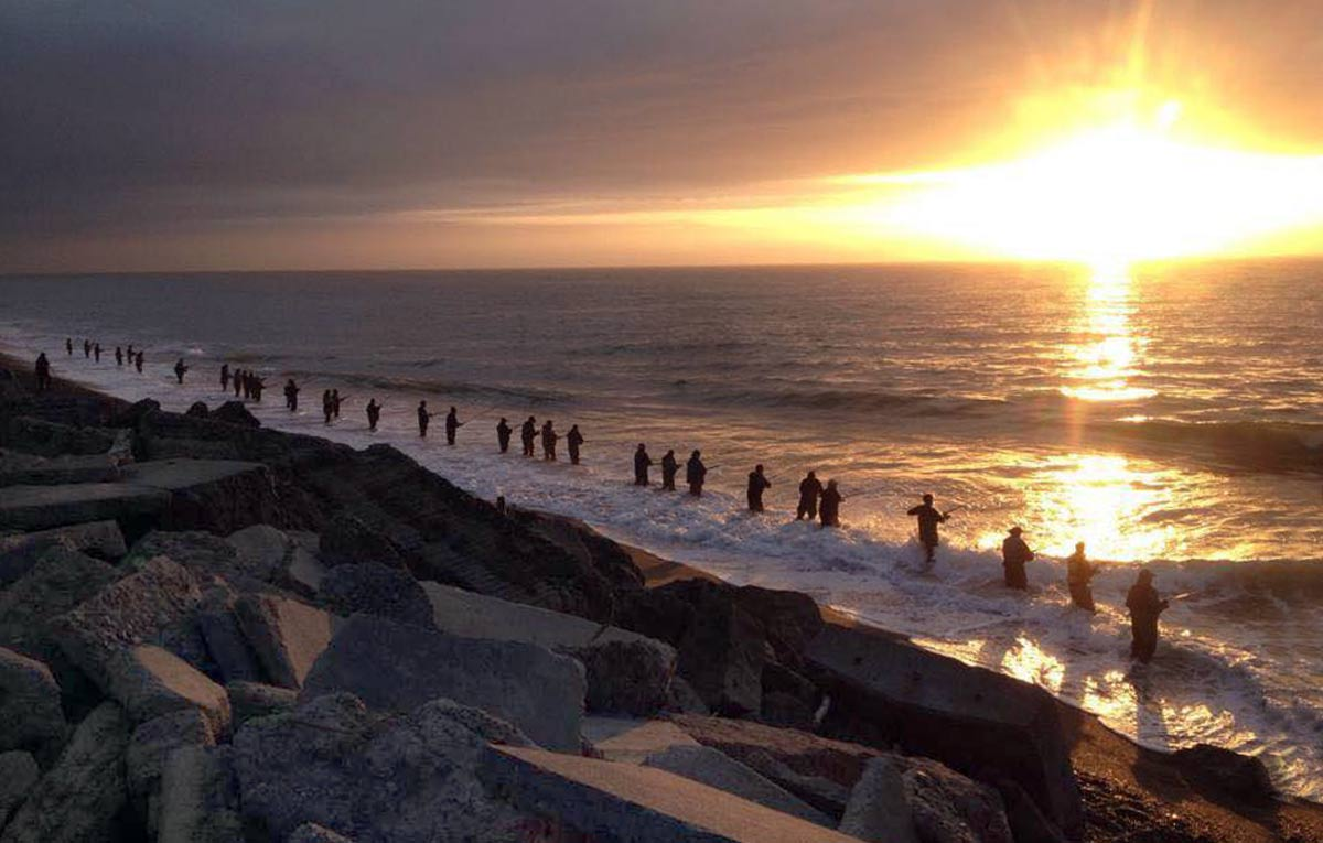 Salmon anglers fishing the surf at sunrise. Orari River mouth. Photograph courtesy of Josh Mcmillian.