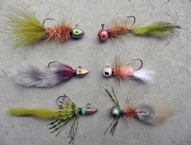 More dressed jigs from Paul Spicer. Note the length of the tail on the olive green jig at bottom left. These long rabbit strip tails look amazingly fish-like in the water. Photograph courtesy of Paul Spicer.