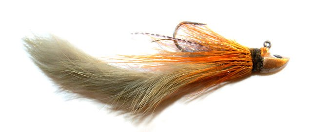 Here is another rabbit lure jig pattern that has worked well for me. The pelt has been dyed light-green. I've added a colour of long orange/brown hackle. Note also a few strips of rubber legs for good measure. When tying dressed jigs you can go a bit wild with your materials and colours!
