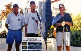 Doug Payton (right) with his 60th birthday 105 kg striped marlin caught near Astrolabe Reef.