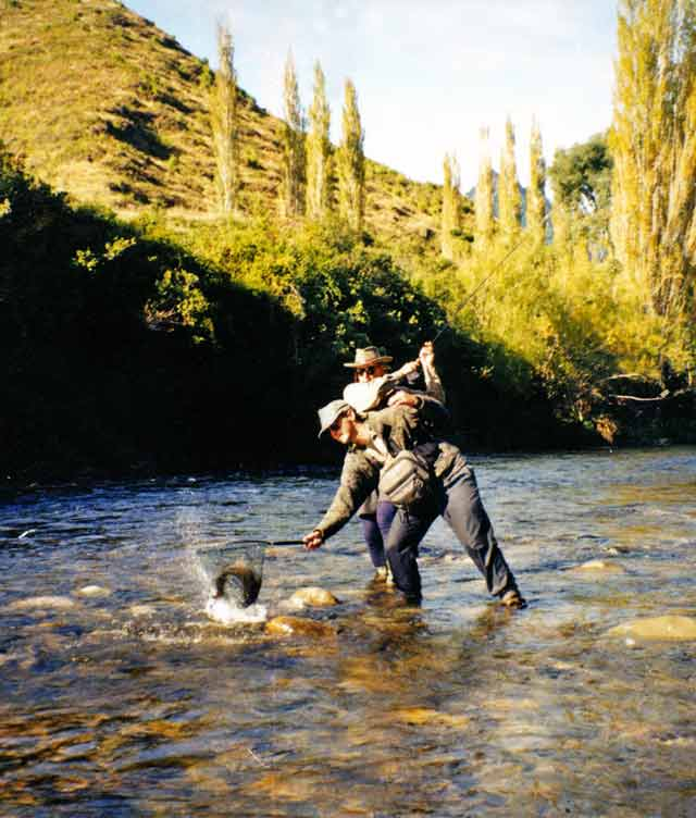 Graeme Smith being assisted by West Coast guide Zane Murfin. Fly Fishing Getting Started