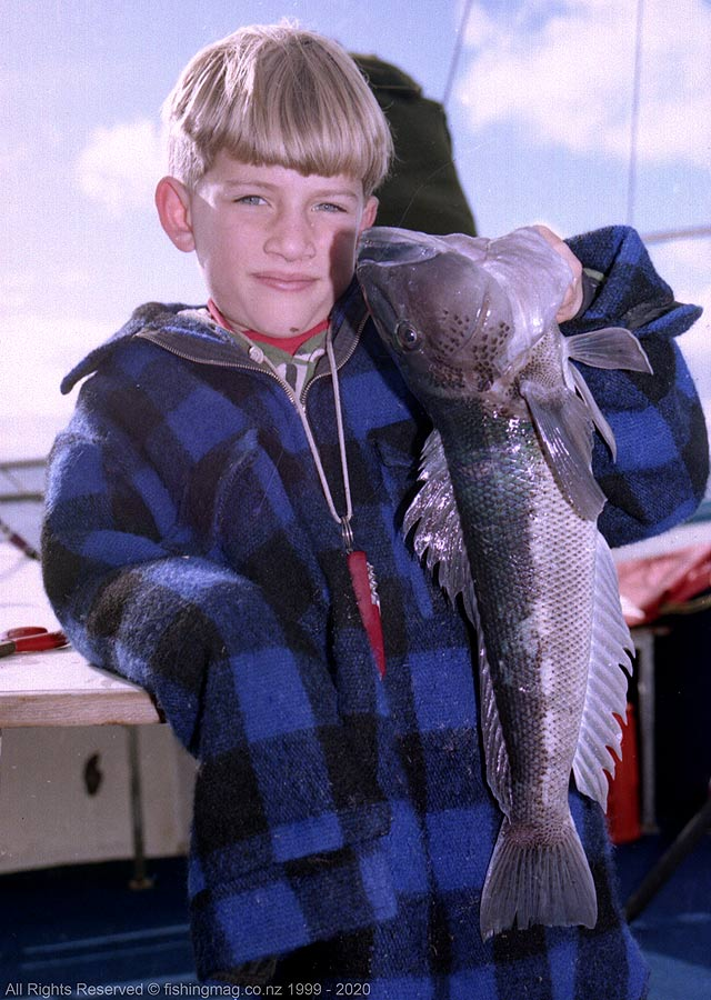 Samuel Beaufill looks pleased with his catch. Sam has caught one of the big blue cod for which the Stewart Island area is well known.