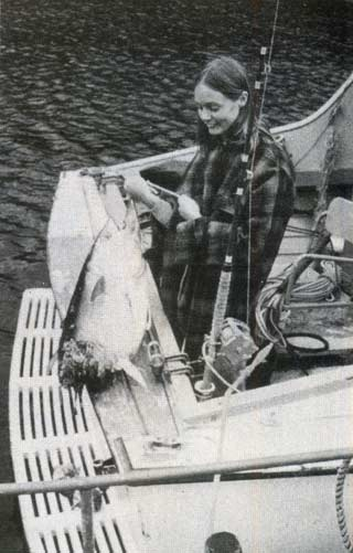 Aileen Cook with the result of a mako attack on a hooked bluefin tuna.