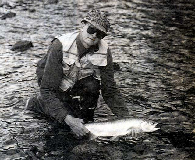 Glen Eggleton releases a big Hollford River rainbow.