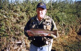 Monty Wright with rainbow trout. An eye for the water.
