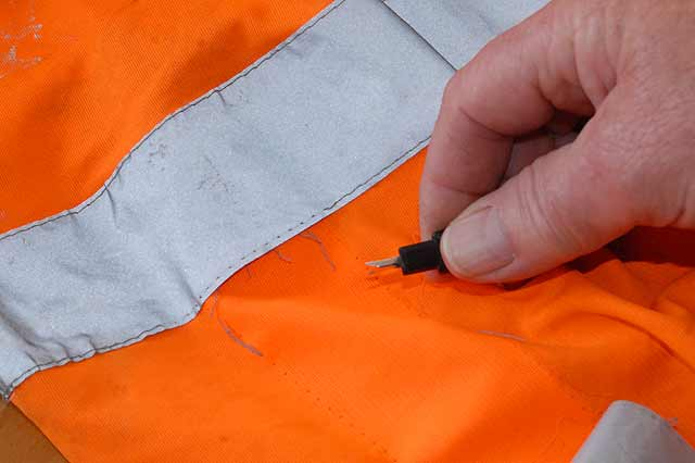 The quick-un-pick makes removing the reflector tape from the vest easy and safe.
