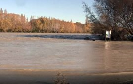 "The Waimakariri River in flood- no fishing today! A 1000 years ago the Waimakariri River ran into Lake Ellesmere. It is now ""fenced"" in by stopbanks."