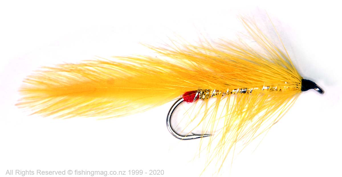 Yellow Terror created by Robert Bragg. Tied by Allan Burgess. It has a palmered hackle over tinsel body and Matuku wing.