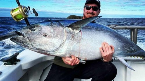 Nick Best and his massive southern bluefin tuna caught trolling off Waihau Bay, in the Bay of plenty. Photo sourtesy of Nick Best.