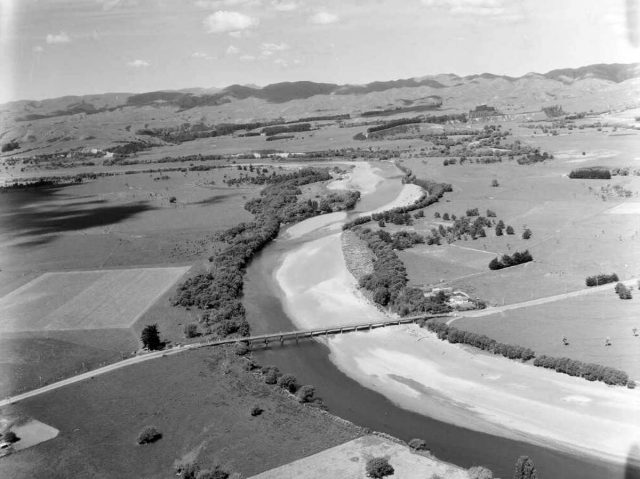 "Rural scene near Martinborough and Ruamahanga River, Wairarapa, Wellington Region 1958. Photo ""Whites Aviation Collection, Alexander Turnbull Library"". Discription at bottom of page."